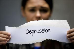 Girl holding 'depression' sign